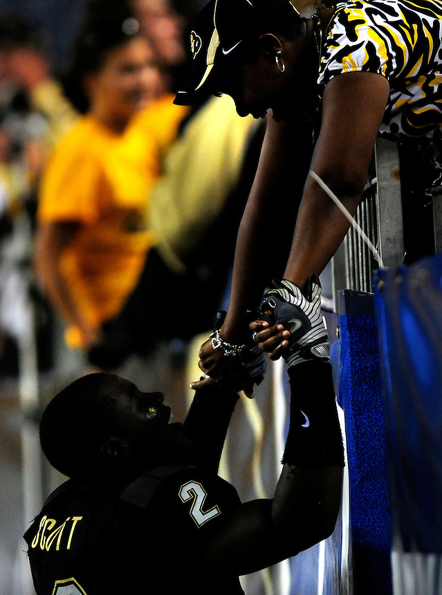 31 Aug 2008: Colorado running back Darrell Scott is greeted by an acquaintence after a game against Colorado State. The Colorado Buffaloes defeated the Colorado State Rams 38-17 at Invesco Field at Mile High in Denver, Colorado. FOR EDITORIAL USE ONLY