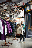 USA, Colorado, Aspen, a young woman shops at store called Jet Set in downtown Aspen