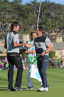 160213 Actor Mark Wahlberg with Bubba Watson on the 18th after Saturday's Third Round of The AT&T National Pro Am at The Pebble Beach Golf Links in Carmel, California. (photo credit : kenneth e. dennis/kendennisphoto.com)