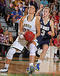 SPEARFISH, SD - DECEMBER 3, 2015 -- Sierra Toms #32 of Black Hills State drives past Kahlie Peterson #3 of South Dakota Mines during their college basketball game Saturday at the Donald E. Young Center in Spearfish, S.D. (Photo by Dick Carlson/Inertia)
