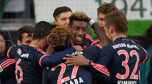 27.02.2016. Wolfsburg, Germany.  Munich's Kingsley Coman (c) celebrates his goal for 0:1 during the German Bundesliga football match between VfL Wolfsburg and FC Bayern Munich at the Volkswagen-Arena in Wolfsburg, Germany