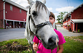 Paige Wolfe with her horse, Spider, in Cornwall, Pennsylvania.