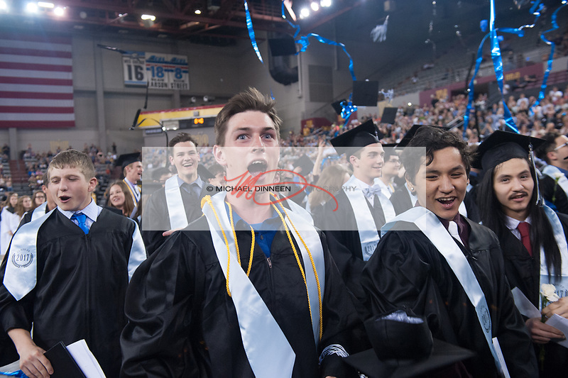 1214<br /> <br /> Chugiak grad Austin Potter exults as the ceremonies end.  Photo for the Star by  Michael Dinneen.