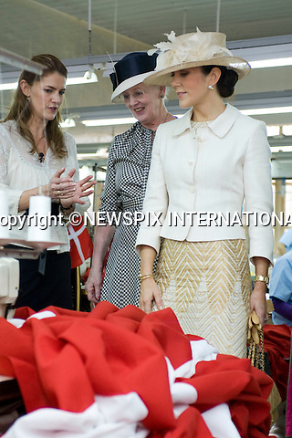 """Queen Margrethe and Crown Princess Mary visit a the My Anh Flag Factory, where they toured the Temple, flag cutting room the factory's production line.The Danish Royal Family on the first official day of their State Visit to Vietnam. Ha Tay, Vietnam_02/11/2009..Mandatory Photo Credit: ©Dias/Newspix International..**ALL FEES PAYABLE TO: """"NEWSPIX INTERNATIONAL""""**..PHOTO CREDIT MANDATORY!!: NEWSPIX INTERNATIONAL(Failure to credit will incur a surcharge of 100% of reproduction fees)..IMMEDIATE CONFIRMATION OF USAGE REQUIRED:.Newspix International, 31 Chinnery Hill, Bishop's Stortford, ENGLAND CM23 3PS.Tel:+441279 324672  ; Fax: +441279656877.Mobile:  0777568 1153.e-mail: info@newspixinternational.co.uk"""