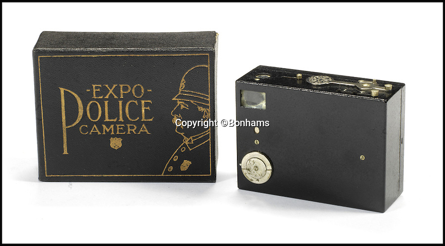 BNPS.co.uk (01202 558833)Pic: Bonhams/BNPS<br /> <br /> Expo Police camera. Estimate &pound;770 - &pound;1,400.<br /> <br /> An incredible archive of rare vintage spy cameras that would rival James Bond's own collection has emerged for sale for a staggering &pound;400,000.<br /> <br /> The Heath Robinson-style cameras date from the 1880s and come in numerous wacky guises including a book, a wristwatch, a packet of cigarettes, binoculars and even a handgun.<br /> <br /> Many of the ingenious devices were commercial failures and so very few were made, making surviving examples worth tens of thousands of pounds now.<br /> <br /> The collection will be sold at London auctioneers Bonhams on December 3.