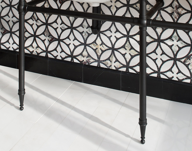 "Omar, a hand-cut and waterjet stone mosaic, shown in polished Thassos, Plumeria, and tumbled Nero Marquina with 6"" x 24"" polished Thassos bricks."