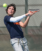 STAFF PHOTO ANTHONY REYES &bull; @NWATONYR<br /> Derek Groomer, of Rogers Heritage, returns a volley during the 7A-West Conference girls and boys tennis tournament Wednesday, Oct. 8, 2014 at the Springdale Har-Ber tennis courts.