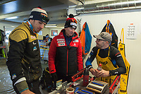 Switzerland. Canton Ticino. Swiss-Cups Campra. Cross Country Skiing. FIS Classic Sprint Race. Hippolyt Kempf (C) is the Cross Country Skiing Chef by Swiss-Ski. He stands in the technical area used by servicemen to prepare skis before the race. He talks to two men working with the Swiss French team. Hippolyt Kempf (born 10 December 1965) is a Swiss Nordic combined skier who competed during the late 1980s and early 1990s. He won a complete set of Olympic medals, earning two of them at the 1988 Winter Olympics in Calgary (gold: 15 km individual, silver: 3 x 10 km team) and the third at the 1994 Winter Olympics in Lillehammer (bronze: 3 x 10 km team). Kempf also earned a 3 x 10 km team silver medal at the 1989 FIS Nordic World Ski Championships in Lahti. Swiss-Ski is a branch of Swiss Olympic. The Fédération Internationale de Ski (FIS; English: International Ski Federation) is the world's highest governing body for international winter sports. Founded  on 2 February 1924, it is responsible for the Olympic disciplines of cross-country skiing. The FIS is also responsible for setting the international competition rules. 4.01.2020 © 2020 Didier Ruef