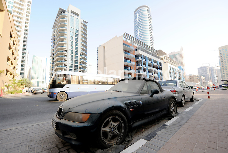 **ALL ROUND PICTURES FROM SOLARPIX.COM**.**WORLDWIDE SYNDICATION RIGHTS**.Dubai house prices fell by 24 per cent in the second quarter due to the economic slowdown in the country. Dubai, UAE. 11 August 2009..This pic:  A BMW convertible sports car parked in the streets of Dubai Marina looking like it has been dumped. 28 June 2009 ..JOB REF: 9741 DBL     DATE: 11_08_2009.**MUST CREDIT SOLARPIX.COM OR DOUBLE FEE WILL BE CHARGED**.**MUST NOTIFY SOLARPIX OF ONLINE USAGE**.**CALL US ON: +34 952 811 768 or LOW RATE FROM UK 0844 617 7637**
