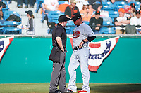 Visalia Rawhide manager Shawn Roof (4) argues with home plate umpire Chris Presley-Murphy during a California League game against the San Jose Giants on April 13, 2019 at San Jose Municipal Stadium in San Jose, California. Visalia defeated San Jose 4-2. (Zachary Lucy/Four Seam Images)