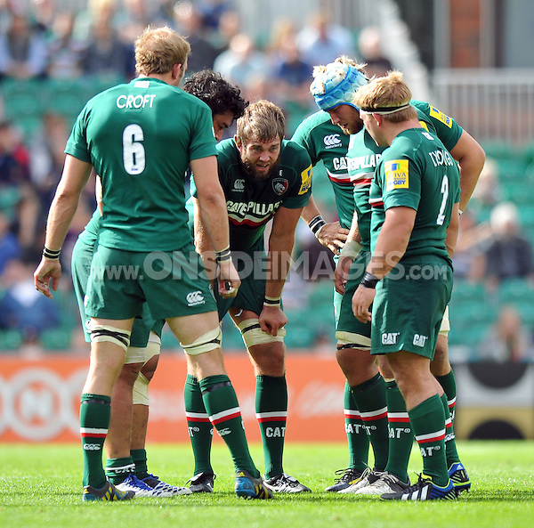 The Leicester Tigers forwards huddle together prior to a lineout. Aviva Premiership match, between Leicester Tigers and Worcester Warriors on September 8, 2013 at Welford Road in Leicester, England. Photo by: Patrick Khachfe / JMP
