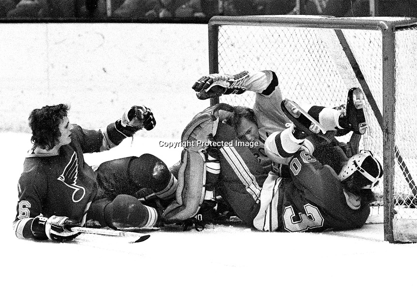 Seals vs. St.Louis Blues...Stan Gilbertson lands in the net on top of Blues goalie Joe Noris, Noel Picard on ice.(1972 photo/Ron Riesterer)
