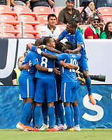 DENVER, CO - JUNE 19: Martinique players celebrate a goal during a game between Martinique and Cuba at Broncos Stadium on June 19, 2019 in Denver, Colorado.