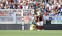 Calcio, Serie A: Roma vs Sassuolo. Roma, stadio Olimpico, 20 settembre 2015.<br /> Roma&rsquo;s Francesco Totti, right, celebrates with teammate Miralem Pjanic after scoring during the Italian Serie A football match between Roma and Sassuolo at Rome's Olympic stadium, 20 September 2015.<br /> UPDATE IMAGES PRESS/Isabella Bonotto