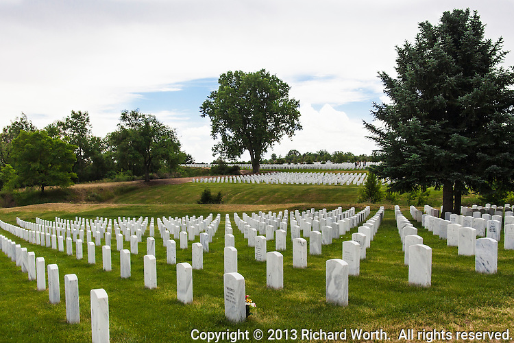 Rows of marble headstones at Fort Logan National Cemetery, Denver, Colorado