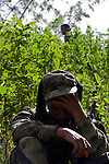 A Colombian soldier rests while they clean the area of explosive devices placed by guerrilla groups and criminal gangs. during a coca plants eradication program at the Antioquia mountains In Colombia so far this year have been eradicated 900 hectares in the country, mainly in rural areas, there are about 2,500 men engaged in this work. According to the Presidential Program for Comprehensive Action against Antipersonnel Mines, between 1990 and January 31, 2012, have been affected by landmines l9.642 people, of these, 674 were injured in eradication. Medellín, July 3 of 2012. Photo by Fredy Amariles/ VIEWpress.