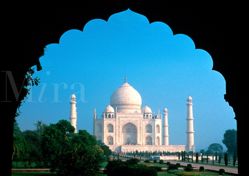 Taj Mahal seen through silhouetted window, Agra, India