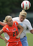 24 September 2006: Miami's Kristen Kenney (23) and UNC's Ashley Moore (behind). The University of North Carolina Tarheels defeated the University of Miami Hurricanes 6-1 at Fetzer Field in Chapel Hill, North Carolina in an NCAA Division I women's soccer game.