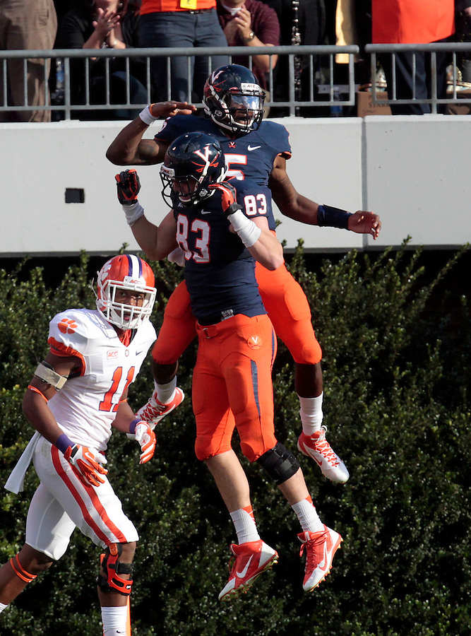 Virginia quarterback David Watford (5) reacts with teammate tight end Jake McGee (83) after scoring the only touchdown of the game against Clemson Saturday at Scott Stadium in Charlottesville, VA. Clemson defeated Virginia 59-10.  Photo/Andrew Shurtleff