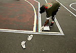 Scenario Hillman paints a line on a basketball court in New York City as part of his volunteer service on August 31, 2006.  The players were in town for the Elite 24 Hoops Classic, which brought together the top 24 high school basketball players in the country regardless of class or sneaker affiliation.