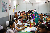 Nurses take down the detail of the patients at the general OPD of the Duncan Hospital in Raxaul, Bihar, India.