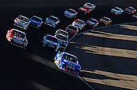 Mar 2, 2008; Las Vegas, NV, USA; NASCAR Sprint Cup Series driver Ryan Newman (12) leads a pack of cars during the UAW Dodge 400 at Las Vegas Motor Speedway. Mandatory Credit: Mark J. Rebilas-US PRESSWIRE