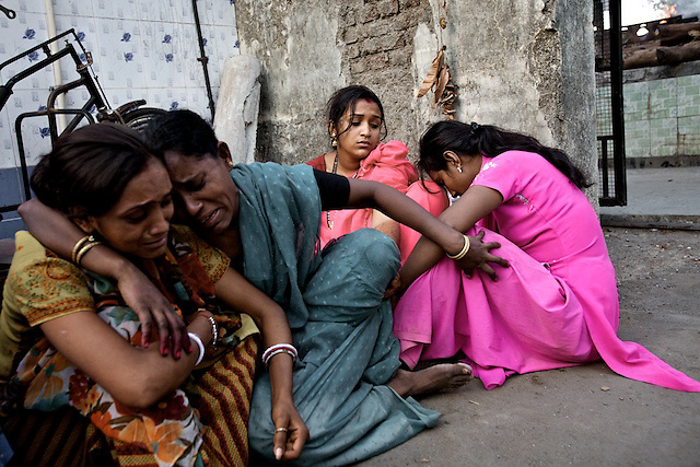 Mumtaz'a sister and eldest daughters wait outside the funeral ground while her body is cremated. Her 18 year old daughter was married whilst her mother was admitted to hospital; during the ceremony she asked repeatedly about her mother's absence, but wasn't told until the marriage was completed.