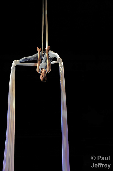 A member of the Modern American Dance Company of St. Louis performs while suspended from the ceiling of the Edward Jones Dome at America's Center during the May 2 concluding worship service of the 2010 Assembly of United Methodist Women in St. Louis, Missouri. Photo by Paul Jeffrey/Response.