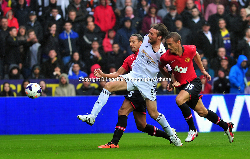 Swansea's Michu held back by Nemanja Vidic.<br />