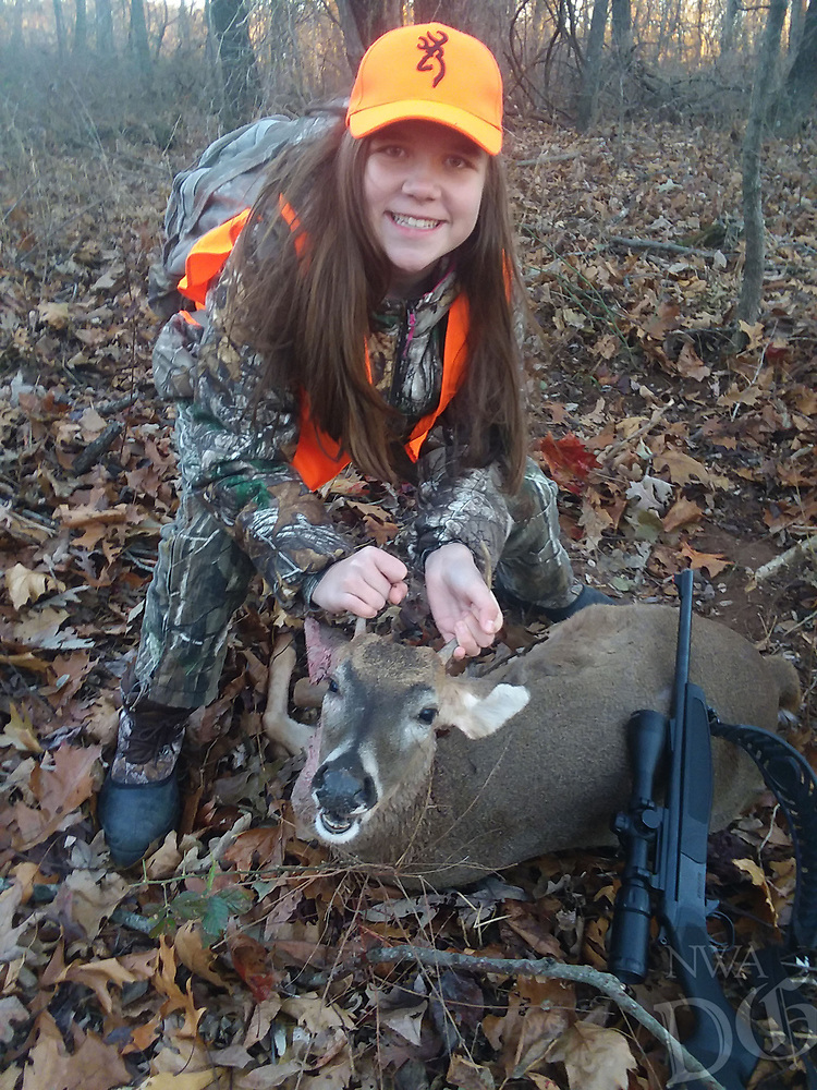 Courtesy photo<br /> DOWN TO THE WIRE<br /> Caroline Clemons, 11, of Prarie Grove shows a buck she took on Dec. 2, the last day of the regular modern gun deer season. Caroline shot a wild hog on opening day, Nov. 10. She and her dad, Josh Myers, hunted near Strickler.