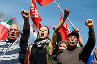 Raised fists<br /> Rome April 6th 2019. Counterdemonstration of activists from the anti-fascist movements in the Torre Maura district of Rome, two days after Rome residents and neo-fascists burned bins and shouted racist slogans at Roma families being temporarily hosted in their neighbourhood. <br /> photo di Samantha Zucchi/Insidefoto