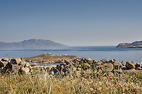 A view from the shore on the Greek island of Mykonos overlooking Agios Georgios island.