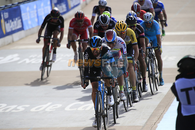 The chase group of riders with Sir Bradley Wiggins (GBR) Team Sky on the front enter the famous Roubaix Velodrome at the end of the 113th edition of the Paris-Roubaix 2015 cycle race held over the cobbled roads of Northern France. 12th April 2015.<br /> Photo: Eoin Clarke www.newsfile.ie