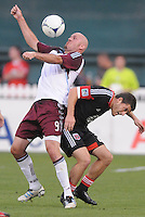 Colorado Rapids forward Conor Casey (9) goes against D.C. United defender Daniel Woolard (22)  D.C. United defeated the Colorado Rapids 2-0 at RFK Stadium, Wednesday May 16, 2012.