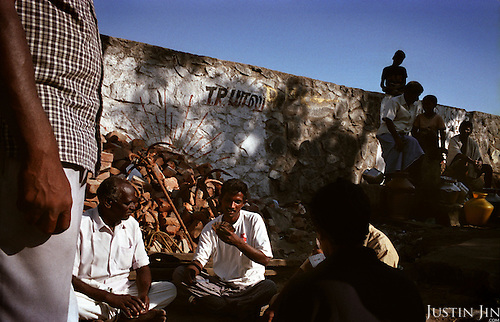 Fishermen play cards in a village near Chennai, on the southeastern coast of India, after their boats were sank by the tsunami. Many complain of slow assistance from the goverment..The December 26, 2004 tsunami killed thousands of people along this coast, smashing boats, roads and houses and tearing thousands of families apart. .Picture taken February 2005 in Nagapptinam, Tamil Nadu, India, by Justin Jin
