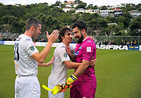 James McPeake (left) and Albert Riera congratulate keeper Enaut Zubikarai after the win in the Oceania Football Championship final (second leg) football match between Team Wellington and Auckland City FC at David Farrington Park in Wellington, New Zealand on Sunday, 7 May 2017. Photo: Dave Lintott / lintottphoto.co.nz