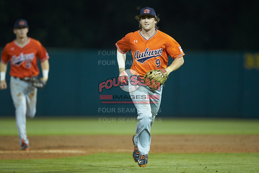 Auburn Tigers second baseman Luke Jarvis (9) smiles as he jogs off the field after having made a nice defensive play for the third out of the inning against the Army Black Knights at Doak Field at Dail Park on June 2, 2018 in Raleigh, North Carolina. The Tigers defeated the Black Knights 12-1. (Brian Westerholt/Four Seam Images)