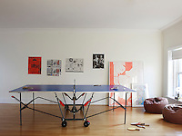 The games room is furnished with a collapsible table tennis table and a pair of leather bean bags