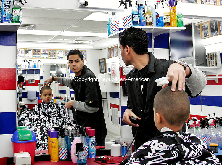 WATERBURY, CT-28 JANUARY 2009-012809BF03--  Barber William Rodriquez, 24, of Waterbury cuts the hair of Amalyki Briley, 5, also from Waterbury Wednesday afternoon at El Rey de la Tijera on Chase Avenue in Waterbury. Rodriquez, a native of Coamo, Puerto Rico, said he has been cutting hair for seven years. He has worked for El Rey de la Tijera for the past two years.  Waterbury officials arfe hoping the state allows spanish speaking barbers and hairdresses to take the English-only licensing exam in Spanish or with the use of a translator.  Bob Falcetti Republican-American