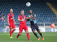 Marcus Bean of Wycombe Wanderers and James Berrett of York City battle for the ball during the Sky Bet League 2 match between Wycombe Wanderers and York City at Adams Park, High Wycombe, England on 8 August 2015. Photo by Andy Rowland.