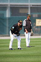 Pittsburgh Pirates Garth Brooks (7) jokes with coach Kimera Bartee (18) during the teams first Spring Training practice on February 18, 2019 at Pirate City in Bradenton, Florida.  (Mike Janes/Four Seam Images)