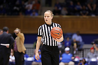 DURHAM, NC - NOVEMBER 17: Match official Katie Lukanich holds the ball during a game between Northwestern University and Duke University at Cameron Indoor Stadium on November 17, 2019 in Durham, North Carolina.