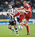ABERDEEN'S ANDREW CONSIDINE NARROWLY MISSES ST MIRREN'S DOUGIE IMRIE WITH AN ERRATIC KICK TRYING TO CLEAR