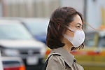 March 8, 2013, Tokyo, Japan :  A woman is seen wearing a protective face mask in downtown Tokyo. Hay Fever and pollution cloud form China hit Japan. In Tokyo, and throughout Japan, Spring is the Hay fever season. Hay fever, or Kafunsho, is most commonly caused by pollen from Cryptomeria and Japanese Cypress, two native Japanese tree species. Japan is particularly subject to hay fever due to the great number of Cryptomeria and Japanese Cypress tree reforestation in the 70s, where these species were important resources for the construction industry. This year the hay fever season is also influenced by the Asian Dust, a flow of dust and pollution brought to Japan from China by strong westerly winds. (Photo by Yohei Osada/AFLO)