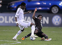 Vancouver Whitecaps FC midfielder Gershon Koffie (26) goes against D.C. United midfielder Clyde Simms (19). D.C. United defeated The Vancouver Whitecaps FC 4-0 at RFK Stadium, Saturday August 13 , 2011.