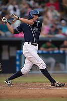 Asheville Tourists right fielder Jordan Patterson #10 swings at a pitch during a game against the Savannah Sand Gnats at McCormick Field July 17, 2014 in Asheville, North Carolina. The Tourists defeated the Sand Gnats 8-7. (Tony Farlow/Four Seam Images)