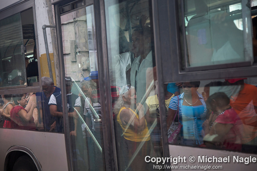 HAVANA, CUBA -- MARCH 25, 2015:   People wait for the P10 bus in Havana, Cuba on March 25, 2015. Photograph by Michael Nagle
