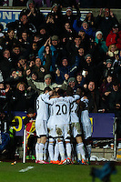 Saturday 2nd Febuaray 2014<br /> Pictured: Wayne Routledge Celebrates with team mates <br /> Re: Barclays Premier League Swansea City FC  v Cardiff City FC at the Liberty Stadium, Swansea