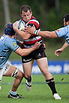 Mark Selwyn tries to bust through between Cam Eyre and Ross Wright. ITM Cup rugby game between Counties Manukau Steelers and Northland, played at Bayer Growers Stadium, Pukekohe, on Sunday September 26th 2010..The Counties Manukau Steelers won 40 - 24 after leading 27 - 7 at halftime.