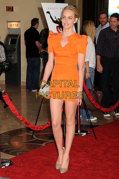 "AMBER VALLETTA.""The Spy Next Door"" Los Angeles Premiere held at The Grove,  Los Angeles, California, USA, .9th January 2010..full length orange dress shoulder pads mini clutch bag beige suede brown shoes  grey gray .CAP/ADM/BP.©Byron Purvis/Admedia/Capital Pictures"